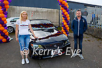 Irene Nagle standing with Barry Pierce who resprayed Ryan's car for the Ryan's Motor Memorial Tractor and Car run in Miltown on Sunday.