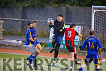 Mainebank keeper Cillian Sayers catches despite the attention of Mastergeeha's Eoin Daly in the Denny Div 2A league final