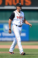 Lansing Lugnuts pitching coach Vince Horsman (26) walks to the dugout from the mound during a game against the Dayton Dragons on August 25, 2013 at Cooley Law School Stadium in Lansing, Michigan.  Dayton defeated Lansing 5-4 in 11 innings.  (Mike Janes/Four Seam Images)
