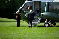 United States President Donald J. Trump salutes as he boards Marine One on the South Lawn of the White House in Washington D.C., U.S., as he departs for Yuma, Arizona on Tuesday, June 23, 2020.  Trump stated that he authorized the Federal government to arrest any demonstrator caught vandalizing U.S. monuments, with a punishment of up to 10 years in prison.  Credit: Stefani Reynolds / CNP/AdMedia