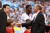 MLS commissioner Don Garber shakes hands with United States defender Heath Pearce (15). The men's national teams of the United States and Argentina played to a 0-0 tie during an international friendly at Giants Stadium in East Rutherford, NJ, on June 8, 2008.