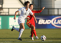 Megan Rapinoe #15 of the USA WNT avoids a tackle by Shanshan Qu #19 of the PRC WNT during an international friendly match at KSU Soccer Stadium, on October 2 2010 in Kennesaw, Georgia. USA won 2-1.