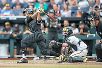 Vanderbilt Commodores third baseman Austin Martin (16) follows through on his swing against the Michigan Wolverines during Game 2 of the NCAA College World Series Finals on June 25, 2019 at TD Ameritrade Park in Omaha, Nebraska. Vanderbilt defeated Michigan 4-1. (Andrew Woolley/Four Seam Images)