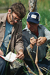 Ernie Kuyt and Rod Drewien taking measurements on juvenile whooping crane
