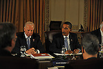 (L-r) Vice-President Elect Joseph Biden and President Elect Barack Obama meet with economic advisers, including newly appointed Chief of Staff Rahm Emanuel seated across from them, at the Hilton hotel in downtown Chicago, Illinois on November 7, 2008.
