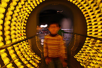 CHINA. Shanghai. A child in a light exhibit in the Shanghai Science and Technology Museum (?????; pinyin: Shàngh?i ke¯jì gu?n) is a large museum in Pudong, Shanghai, close to Century Park, the largest park of the city. The construction of the museum cost 1,75 billion RMB, and the floor area is 98 000m2 .2008..
