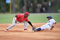 Philadelphia Phillies Wilfredo Flores (2) tags Jimmy Mojica sliding into second base during an Instructional League game against the Detroit Tigers on September 19, 2019 at Tigertown in Lakeland, Florida.  (Mike Janes/Four Seam Images)