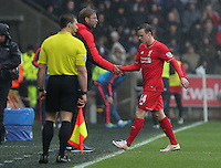Liverpool manager Jurgen Klopp shakes hands with Brad Smith after he saw a red card for his foul against Kyle Naughton during the Barclays Premier League match between Swansea City and Liverpool at the Liberty Stadium, Swansea on Sunday May 1st 2016