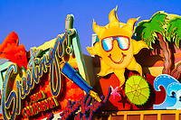 Colorful Universal Studios Hollywood greetings sign under a blue sky, with a fun sun and palm trees, in Los Angeles, California, USA