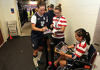 BOCA RATON, FL - DECEMBER 15, 2012: Lauren Cheney (12) of the USA WNT  signs autographs at the end of an international friendly match against China  at FAU Stadium, in Boca Raton, Florida, on Saturday, December 15, 2012. USA won 4-1.