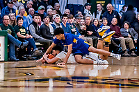 9 February 2019: University at Albany Great Dane Forward Malachi De Sousa, a Freshman from Beacon, NY, fouls University of Vermont Catamount Forward Anthony Lamb, a Junior from Toronto, Ontario, in second-half action at Patrick Gymnasium in Burlington, Vermont. The Catamounts defeated the Danes 67-49 in their America East matchup. Mandatory Credit: Ed Wolfstein Photo *** RAW (NEF) Image File Available ***