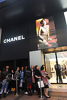 Mainland Chinese consumers line up outside a Chanel shop on Canton Road in Hong Kong. Outbound tourists from mainland China spent some $42 billion overseas (including Hong Kong, Macau and Taiwan) last year, outspending inbound international tourists for the first time. Hong Kong, is a leading destination for mainland.tourists and is leading centre for luxury fashion brands carry the complete range of one of the world's top fashion brands products..