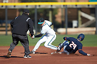 NathanAide (29) of the Illinois Fighting Illini slides into second base ahead of the tag by Brian Port (5) of the Coastal Carolina Chanticleers as umpire Gary Swanson looks on at Springs Brooks Stadium on February 22, 2020 in Conway, South Carolina. The Fighting Illini defeated the Chanticleers 5-2. (Brian Westerholt/Four Seam Images)