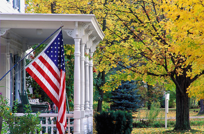 USA, Vermont. Front porch of house with USA flag..NO PROPERTY RELEASE