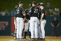 Army Black Knights pitching coach Jamie Pinzino (23) has a meeting on the mound during the game against the Auburn Tigers at Doak Field at Dail Park on June 2, 2018 in Raleigh, North Carolina. The Tigers defeated the Black Knights 12-1. (Brian Westerholt/Four Seam Images)