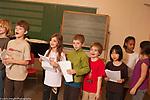 Education Elementary Grade 3 rehearsing musical play
