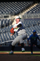 Tanner Burns (32) of the East Team pitches against the West Team during the Perfect Game All American Classic at Petco Park on August 14, 2016 in San Diego, California. West Team defeated the East Team, 13-0. (Larry Goren/Four Seam Images)