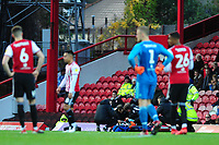 Martin Olsson of Swansea City receives treatment during the Sky Bet Championship match between Brentford and Swansea City at Griffin Park, Brentford, England, UK. Saturday 08 December 2018