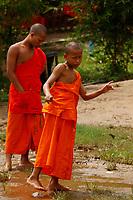 Monks and novices in Wat Pho, near  Luang Prabang, Laos.