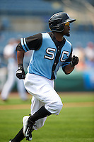 Syracuse Chiefs outfielder Tony Gwynn Jr. (18) runs to first during a game against the Pawtucket Red Sox on July 6, 2015 at NBT Bank Stadium in Syracuse, New York.  Syracuse defeated Pawtucket 3-2.  (Mike Janes/Four Seam Images)