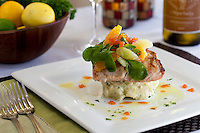 Grilled Mahi-Mahi: crab-smashed potatoes, citrus segments, blood orange caviar, lemon, basil, arugula, citrus-herb vinaigrette<br /> Waterfront Bistro .Cruz Bay, St. John.U.S. Virgin Islands