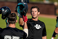 Julian Rip (34) of the USC Upstate Spartans Black team is greeted after hitting a home run in the Green and Black Fall World Series Game 3 on Sunday, November 1, 2020, at Cleveland S. Harley Park in Spartanburg, South Carolina. (Tom Priddy/Four Seam Images)