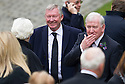 Sir Alex Ferguson and John Greig arrives at Mortonhall Crematorium for the funeral service of Sandy Jardine.