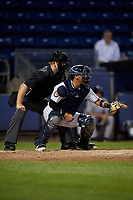 Umpire Kyle Levine and Staten Island Yankees catcher Carlos Gallardo (65) during a NY-Penn League game against the Aberdeen Ironbirds on August 22, 2019 at Richmond County Bank Ballpark in Staten Island, New York.  Aberdeen defeated Staten Island 4-1 in a rain shortened game.  (Mike Janes/Four Seam Images)
