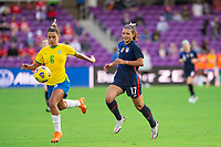 ORLANDO CITY, FL - FEBRUARY 21: Tamires of Brazil and Sophia Smith #17 of the USWNT battle for the ball during a game between Brazil and USWNT at Exploria Stadium on February 21, 2021 in Orlando City, Florida.