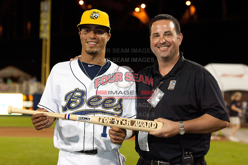 "Nino Leyja (19) of the Burlington Bees is presented the All-Star ""Top Star Award"" by Quad City River Rascals General Manager Kirk Goodman after the Midwest League All-Star Game at Modern Woodmen Park on June 21, 2011 in Davenport, Iowa. (David Welker / Four Seam Images)"