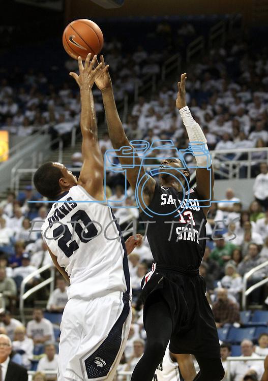 San Diego State's Winston Shepard shoots over Nevada defender Jordan Burris during an NCAA men's basketball game in Reno, Nev., on Wednesday, Jan. 23, 2013. San Diego State won 78-57. (AP Photo/Cathleen Allison)