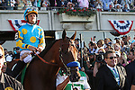 June 6, 2015: American Pharoah, Victor Espinoza up, wins the 147th running of the Grade I  Belmont Stakes and with it the Triple Crown at Belmont Park, Elmont, NY.  Heading to the post parade, a relaxed-looking Victor Espinoza blows bubbles. Joan Fairman Kanes/ESW/CSM