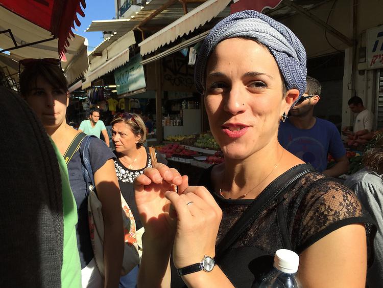 Young woman at Carmel Shuk, the open air market, Tel Aviv