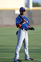 Rashad Harlin #6  of the AZL Rangers warms up before an Arizona League game against the AZL Mariners at the Mariners complex on July 8, 2011 in Peoria, Arizona. (Bill Mitchell/Four Seam Images)