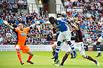 Hearts v St Johnstone...04.08.12.Nigel Hasselbaink heads the ball past Jamie MacDonald only to see it hit the post.Picture by Graeme Hart..Copyright Perthshire Picture Agency.Tel: 01738 623350  Mobile: 07990 594431