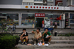 Migrant workers take a lunch break from cleaning up near the Olympic Village in Beijing, China on Monday, August 4, 2008. The city of Beijing is gearing up for the opening ceremonies of the Olympic Games.  Kevin German