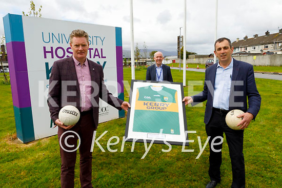 Tim Murphy (Chairman of the Kerry County GAA Committee) and Dr John Rice presenting a Kerry jersey to Fergal Grimes at the UHK as part of a national initiative to recognise Frontline Workers.  L to r: Ann O'Shea, Tim Murphy (Kerry GAA), Fergal Grimes (UHK Manager), Martin Boyd and Karina Gilligan.