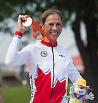 TORONTO, ON, AUGUST 8, 2015. Nicole Clermont Celebrates her bronze medal in women's road race (C1-5) at the ParaPan Am Games.<br /> Photo: Dan Galbraith/Canadian Paralympic Committee