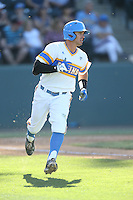 Kevin Kramer (7) of the UCLA Bruins runs to first base during a game against the Oregon State Beavers at Jackie Robinson Stadium on April 4, 2015 in Los Angeles, California. UCLA defeated Oregon State, 10-5. (Larry Goren/Four Seam Images)
