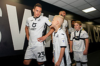 Connor Roberts of Swansea City interacts with a young mascot during the Sky Bet Championship match between Swansea City and Nottingham Forest at the Liberty Stadium in Swansea, Wales, UK. Saturday 14 September 2019