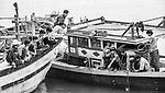 Fishermen on board fishing boats in Rach Gia, Vietnam