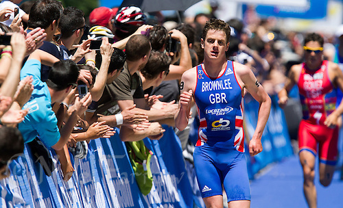 02 JUN 2013 - MADRID, ESP - Jonathan Brownlee (GBR) (second from right, in blue, white and red) of Great Britain leads Javier Gomez (ESP) (right) of Spain on the run during the men's ITU 2013 World Triathlon Series round in Casa de Campo in Madrid, Spain <br /> (PHOTO (C) 2013 NIGEL FARROW)