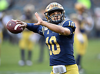 PHILADELPHIA, PA - DEC 14, 2019: Navy Midshipmen quarterback Malcolm Perry (10) throws the ball in warm ups before game between Army and Navy at Lincoln Financial Field in Philadelphia, PA. The Midshipmen defeated Army 31-7. (Photo by Phil Peters/Media Images International)