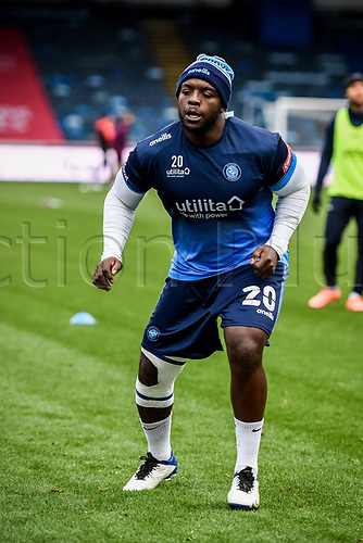 21st November 2020; Adams Park Stadium, Wycombe, Buckinghamshire, England; English Football League Championship Football, Wycombe Wanderers versus Brentford; Adebayo Akinfenwa nurses an injured knee through the warm up.