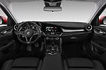 Stock photo of straight dashboard view of a 2017 Alfa Romeo Giulia Veloce 4 Door Sedan