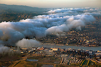 aerial photograph of of Mare Island toward Vallejo near sunset as fog enters the area, Solano County, California