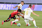 Real Madrid's Mariano Diaz (c) and Toni Kroos (r) and RCD Mallorca's Luka Moreno, youngest rookie in LaLiga history, during La Liga match. June 24,2020. (ALTERPHOTOS/Acero)