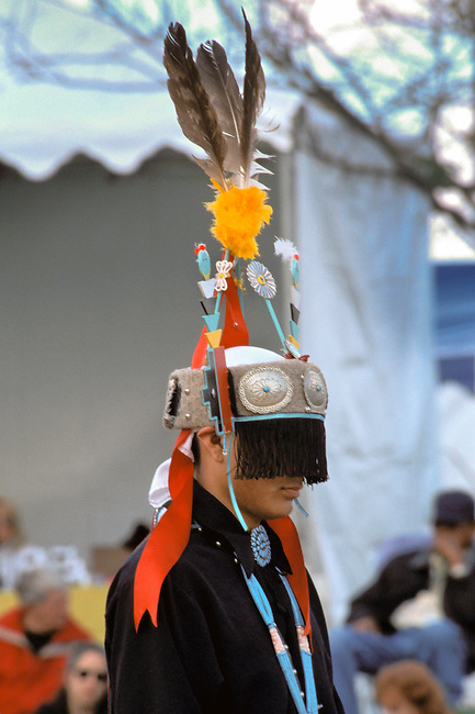 Teenage Navajo boy dressed in traditional headdress and regalia performs with the Dineh Tah Dancers in Phoenix Arizona