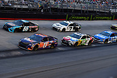 #11: Denny Hamlin, Joe Gibbs Racing, Toyota Camry FedEx Freight, #66: Timmy Hill, Motorsports Business Management, Toyota Camry, #18: Kyle Busch, Joe Gibbs Racing, Toyota Camry M&M's White Chocolate, #7: J.J. Yeley, Premium Motorsports, Chevrolet Camaro Steakhouse Elite, and #17: Ricky Stenhouse Jr., Roush Fenway Racing, Ford Fusion Fastenal