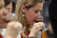 MELBOURNE, 26 MAY - Judge Petra Vesela tastes a drink made by Pete LICATA from USA in the final of the 2013 World Barista Championship in Melbourne, Australia. Licata was announced as the winner in a field of national champion baristas from 53 countries. Photo Sydney Low / syd-low.com